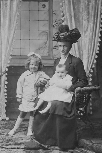 My great grandmother with my mothe, 1915 approx.